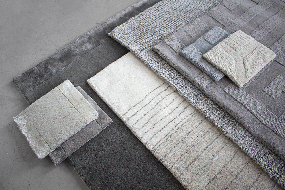 Layered different kinds of wool rug in gray beige and blue