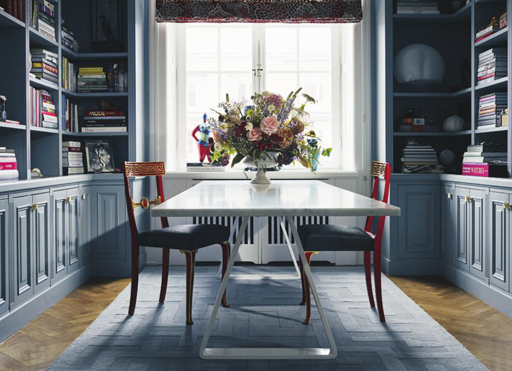 Layered decorate with wool rugs in dining room library